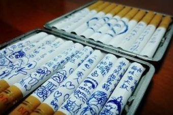 Wife draws cartoons on husband's cigarettes to urge him to stop smoking